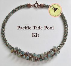 This is a very special textured beaded kumihimo kit. You will receive everything you need to create a 23 inch (maximum but can be made shorter) beaded kumihimo necklace entitled Pacific Tide Pool designed by Diana Miglionico-Shiraishi for Jasmine Tea Designs. The focal grouping created with handcrafted boro beads in southern California are no longer available. The glass rods required to make these boro beads has been discontinued and I made a special production order that completed the…