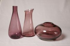 "Sold for $70 in 2008  THREE PIECES OF ERICKSON GRAPE GLASS. Tapered pitcher with partial paper label. 9.75""h. Bud vase with tapered body. 10.5""h. Round vase with ground rim. 5.5""h. 8""d.  Estimate 200 - 300"