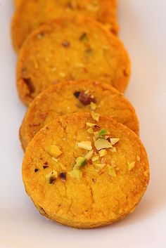 eggless saffron cookies laced with pistachios, cardamom and nutmeg