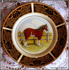 Exquisite four dinner plates set of equestrian English bone china plates featuring hand-painted images of Shire Horses set on exquisite decorated black rims with floral pattern and gild. Collectible, well sought-after rare set which will be valuable addition to any bone china equestrian collection. #equestrianchina #shirehorses #handpainted #horses #foxhunting #collectibles #rarechina #dining #huntinlodge