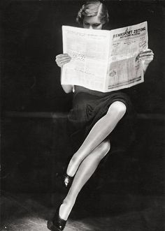 A lady reading newspaper, 1932.