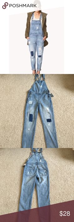 NWT Forever 21 Distressed Overalls Sz 27 Brand new with tags. Distressed overalls in light denim. Has distressing, holes and patches on the front and back. No trades or PayPal. Forever 21 Jeans Overalls
