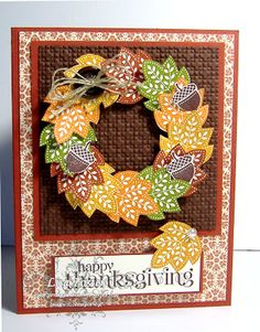 handmade Thanksgiving card ... Day of Gratitude leaves stamped in rich Fall colors, fussy cut and arranged into a wreath ... luv the button with tiny twine bow as an accent ... lattice embossed panel for the wreath ... pattnerned paper for the main layer ... curly script font for the sentiment ... great card!! ... Stampin' Up!
