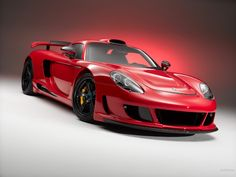 This is a red Porsche Carrera GT. Paul Walker died in the same make and model of this car. So sad:-( Porsche Carrera Gt, Porsche Gt, Porsche Sports Car, Porsche Boxster, Custom Porsche, Bugatti Veyron, Paul Walker, Car Wallpapers, Hd Wallpaper