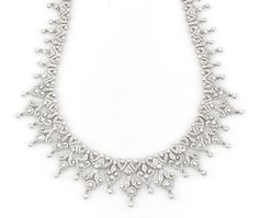 A diamond fringe necklace estimated total diamond weight: 10.00 carats; mounted in eighteen karat white gold