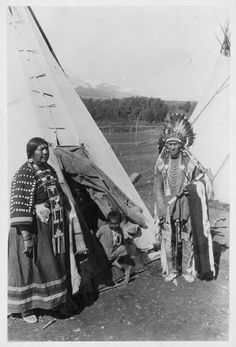 Wolf Plume with wife and child - Blackfoot - no date