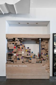 Looks like its made out of wood could also be made out of stacked cardboard. would be good for a small area, different shapes could be made depending on how we arrange the cardboard. -NOOKA Display | SOFTlab | Archinect