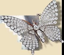Queen Alexandra's Butterfly Brooch with Diamonds The magnificent antique diamond butterfly brooch, with en-tremblant wings and ruby eyes was last seen pictured at a family gathering to celebrate the 80th birthday of the Earl of Harewood in 2003