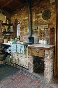 Lovely Open shelves, rustic brick walls and floor with somewhat of a Gothic window. The post Open shelves, rustic brick walls and floor with somewhat of a Gothic window…. Sweet Home, Farmhouse Kitchen Decor, Farmhouse Design, Country Farmhouse, Kitchen Brick, Dirty Kitchen, Rustic Outdoor Kitchens, Primitive Kitchen Decor, Rustic Country Kitchens