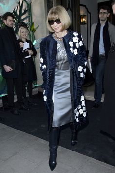 Anna Wintour wearing Prada spring 2013 midnight blue coat with white roses appliqué over a metallic satin dress also by Prada at the Mulberry and Matthew Williamson shows during London Fashion Week Fall/Winter 2013/14 on February 17, 2013 at #Claridge's Hotel in London, England. http://celebhotspots.com/hotspot/?hotspotid=27038=1