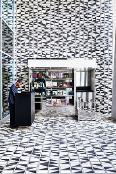 Commercial Interiors. Former Home Savings Bank Building turned the Durham hotel. Lobby wall and floor pattern inspired by Anni Albers. Designer: Commune.