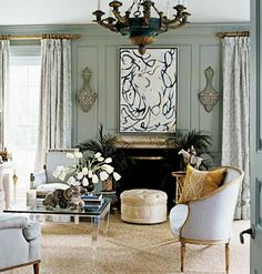 Lovely room with classic furnishings mixed with contemporary painting and coffee table. Love the greenish gray wall color.