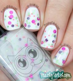"White Owl Lacquers ""Cherry Blossom"" has green, purple, dark pink and fuchsia glitter in a milky white base."