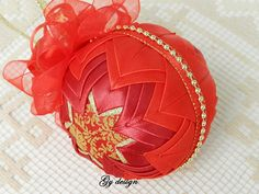 This lovely Christmas ornament is made with red and wine satin ribbon combination and gold thread crocheted band using techniques patchwork ( pineapple). The handmade crocheted band is made based on my idea on a red rhinestones string (crystal mesh). This bauble is create on my own unique design and is carefully handmade with love. It is a very delicate Christmas bauble. It will sparkle on your Christmas tree or can displayed on a stand in your living. Its a perfect gift for the family or… Christmas Baubles, Christmas Crafts, Christmas Tree, Quilted Ornaments, Red Rhinestone, Thread Crochet, Creations, Delicate, Ribbon