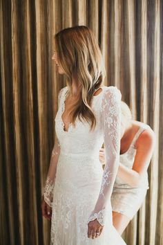 Totally stunning delicate fall wedding dress with lace sleeves -- LOVE it! | http://www.weddingpartyapp.com/blog/2014/09/02/45-long-sleeved-wedding-dresses-for-fall-brides/