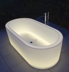 translucent bathtubs presented at Cersaie 2011 and designed by the Belgian designer Michel Boucquillon for Antonio Luppi
