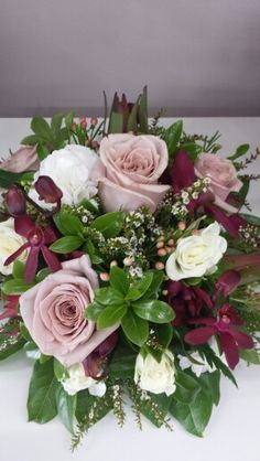 Antique roses,burgundy orchids and spray roses
