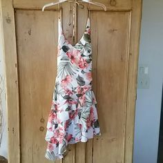 "Flirty angle dress!  Great condition! Fun Hawaiian floral print. Halter with bra padding built-in.   Great condition.  Longest length from back of halter is 24"". mariposa Dresses"