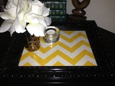 This 13X11 inch black frame makes for a pretty serving tray. Made from a 2nd hand frame that receieved several coats of glossy black paint and chevron print fabric beneath the glass. With its makeover its ready to sit on your coffee table as a tray. You can even conceive to hang it on the wall as art or as a dry erase board. Livng Room, Coffee Table Makeover, Frame Tray, Dry Erase Board, Apartment Ideas, Printing On Fabric, Repurposed, Chevron, New Homes