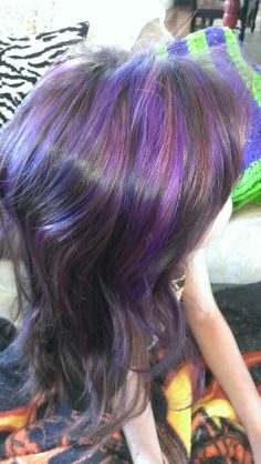 Alyssa's new hair color . Purple highlights