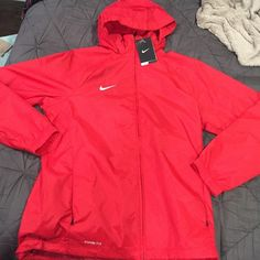 Nike windbreaker Red Nike windbreaker BRAND NEW WITH TAGS. Size XL In youth. Can fit women's and men's. Nike Jackets & Coats