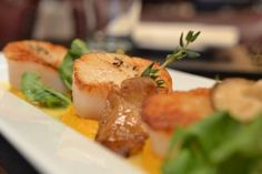 At Brasserie Cognac East , NYC....Looking for something light for dinner, then try the three lightly seared sea scallops over a pumpkin puree sauce, with some wild mushrooms and watercress with chardonnay sauce and amaretto reduction ($27). Worth the trip.