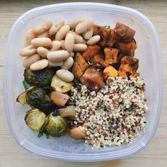 Lunches packed for the week have looked like this: bed of arugula  roasted sweet potatoes  tricolor quinoa  roasted brussels & onions  white beans usually paired with a hardboiled egg for some egg-xtra protein  Worlds longest week is alllmost to a close. Hope y'all have had a great week!!! #notsaddesklunch by foodfitnessandfaith