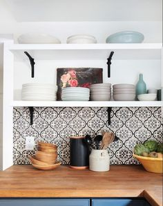 I'm loving these Mediterranean style tiles on a backsplash!
