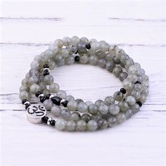 #labradorite #intuition #mala #onyx #om Om Pendant, Levels Of Understanding, Black Tourmaline, Intuition, Labradorite, Beaded Bracelets, Gemstones, Beads, Silver