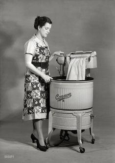"""""""Connor washing machine with motorized wringer."""" Circa 1950 photo."""