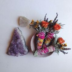 Floral smudges beside a piece of clear quartz and amethyst. The Wiccan's Glossary Wiccan, Witchcraft, Tarot, Mystique, Smudge Sticks, Natural Crystals, Smudging, Crystal Healing, Wands