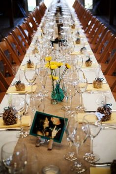 Simple table with pop of color along the way. Burlap runner, bud vases, bright flowers.