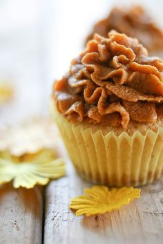 Pumpkin pie cupcakes with a graham cracker bottom.