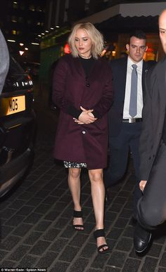 Looking leggy: As she gracefully sauntered into the night clasping her hands down in front...