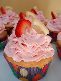 HEY! Look what I have for you! Cake, filling and frosting, piled into a fluted glass and garnished with fresh fruit. They are begging to be demolished by your spoon. Strawberry-lemony goodness in e...