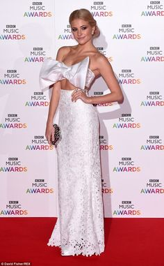 All wrapped up! Pixie Lott leads the way at the star-studded BBC Music Awards in a large bow crop-top and fitted skirt http://dailym.ai/1yFgfpx