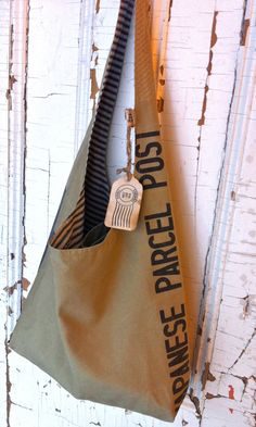 JAPANESE POST reconstructed japanese mail sack sling by yahbag, $280.00