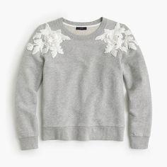 """A fitted sweatshirt + a fun floral appliqué = the best dressy-meets-casual sweater around. <ul><li>Slightly loose fit.</li><li>Body length: 22"""".</li><li>Cotton.</li><li>Long sleeves.</li><li>Machine wash.</li><li>Import.</li></ul>"""