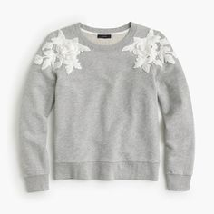 """A fitted sweatshirt + a fun floral appliqué = the best dressy-meets-casual sweater around. Slightly loose fit.Body length: 22"""".Cotton.Long sleeves.Machine wash.Import."""