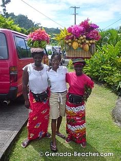 Back in Grenada, the capital of wearing fruit on your head. Nice selection of fruit and flowers.