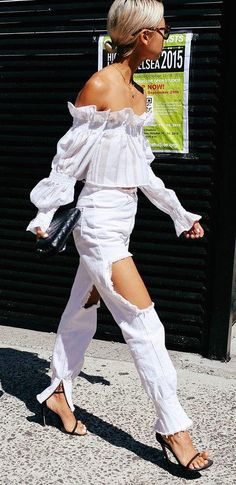 Vanessa Hong in distressed white denim, an off-the-shoulder top, and a black quilted Chanel bag