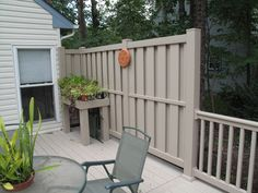 This tan, vinyl, shadowbox fence is done using Great Railing products. Contact us today for more fencing information!
