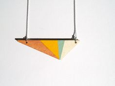 Long silver colored ballchain necklace +/- 70cm Colors: mintgreen, bronze, yellow. Hand painted wooden pendant.