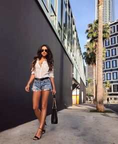 Shay Mitchell | classic white button-up, ripped-jean shorts, and heels