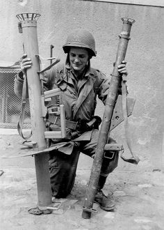 A U.S. soldier with a German Panzerschreck and a U.S. bazooka, in Normandy (June 1944)