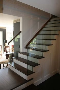 I like this glass stair railing system a lot.  It realy looks like it belongs in a home with the wooden hand rail.  I just wonder how its secured.  At first glance, there are no posts.