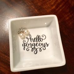 This Hello Gorgeous square jewelry dish and catch all is perfect for you or as a gift for a friend. Ring dishes are great on your beside