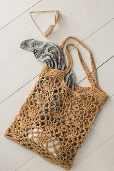 Experiment with plant fibers with this exciting abaca-cotton–blend yarn in the Light of Day Tote by Donna Childs. The unique yarn shines in this open lace stitch, creating a crochet bag perfect for a trip to the farmer's market or… Continue Reading → Crochet Market Bag, Crochet Tote, Crochet Handbags, Crochet Purses, Knit Crochet, Crochet Summer, Free Crochet, Crochet Cardigan, Crochet Shell Stitch