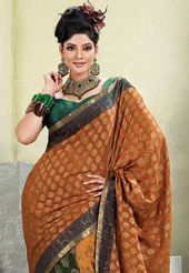 This deep mustard viscose lehenga style saree is beautified with resham, sequins and patch patti work in shape of floral and paisley motif. Lehenga part of the saree is beautified with multicolor viscose. As shown contrasting green lama blouse can be made available and also can be customized as per your style or pattern subject to fabric limitation. Slight variation in color and patch patti pattern is possible.