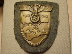 The Crimea Shield (German: ''Krimschild') was a World War II military decoration of Nazi Germany awarded to military personnel who participated in the Crimean Campaign between 21 September 1941 and 4 July Military Decorations, Military Personnel, Porsche Logo, World War Ii, Campaign, September, Germany, World War Two, Wwii